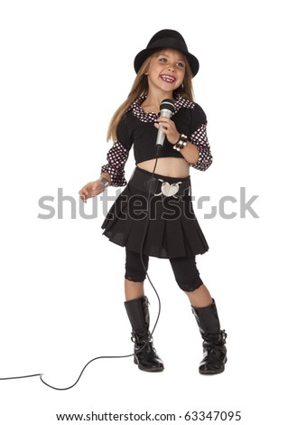 Full length front view studio photo of trendy young girl singing with microphone, isolated on white. - stock photo
