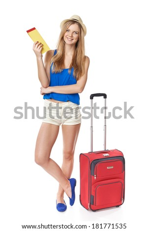 Full length funky teen girl in shorts and straw hat standing with travel bag, holding tickets, isolated on withe background - stock photo