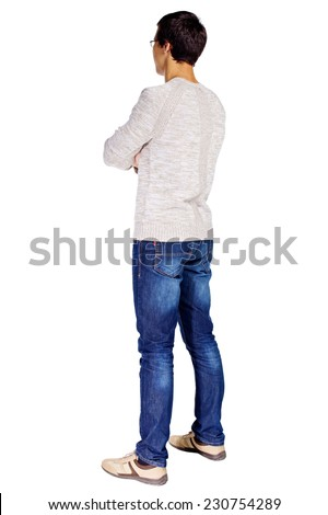 Full length half turn back view portrait of young man in glasses and beige sweater with crossed arms on his chest isolated on white background - stock photo