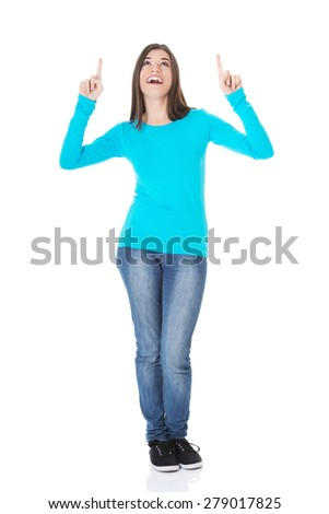 Full length happy woman pointing up. - stock photo