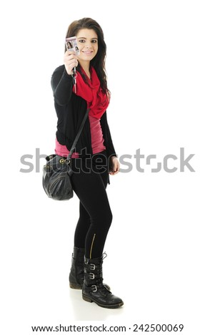 Full-length image of a beautiful teen happily showing off her just-received driver's license.  On a white background. - stock photo