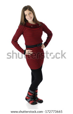 Full length image of a beautiful young teen in her knit red and black striped dress, black tights and crazy socks.  On a white background. - stock photo