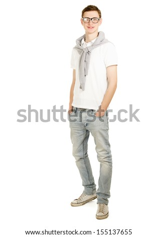 Full length image of a handsome young guy standing isolated against white