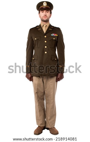 Full length image of army man standing in attention - stock photo