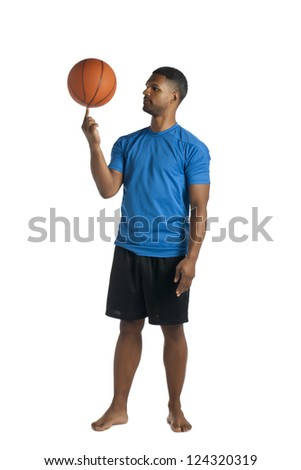 Full length image of black man spinning a ball on his index finger - stock photo