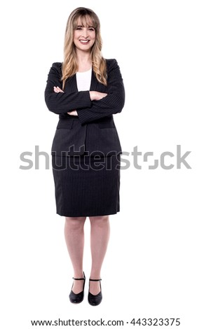 Full length image of business woman with folded arms.