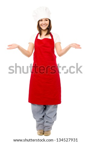 Full length image of charming young female chef isolated on white.
