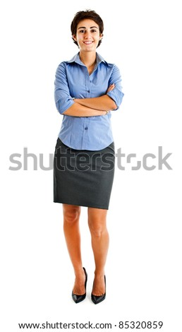 Full length image of confident business woman with hands folded over white background