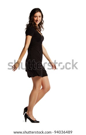 Full length image of confident young woman walking over white background