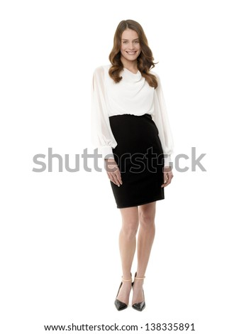 Full length image of successful young businesswoman on white background - stock photo