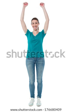 Full length image of young woman raising her hands - stock photo
