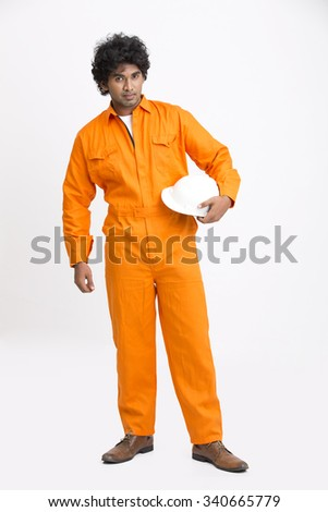 Full length Indian municipal young worker posing with white hat on white background. - stock photo