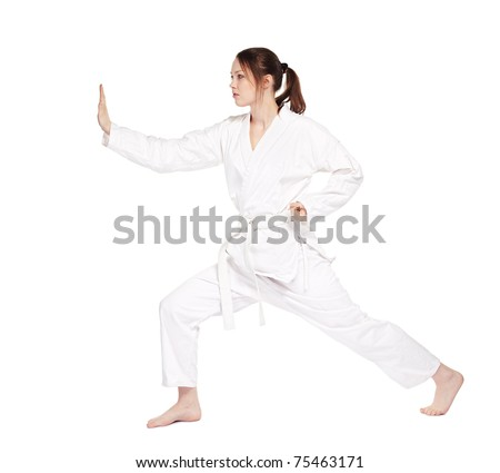 full-length isolated portrait of beautiful martial arts girl in kimono excercising karate kata