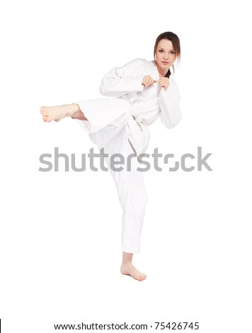 full-length isolated portrait of beautiful martial arts girl in kimono excercising karate kata kick - stock photo