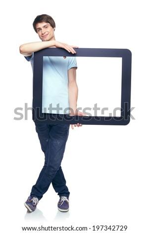 Full length man holding tablet frame, over white background - stock photo