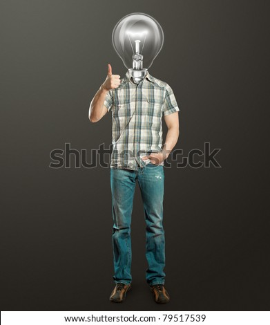 full length man with lamp shows well done against different backgrounds - stock photo