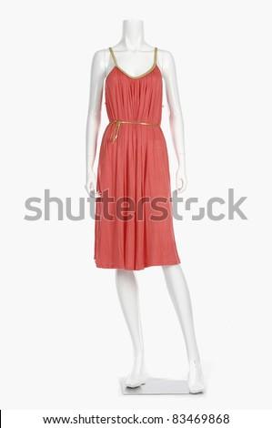 Full length mannequin dressed in orange evening - stock photo