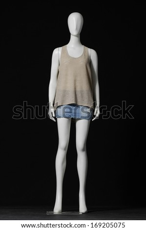 full-length mannequin female dressed in shirt and short on black background