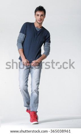 Full length mature casual man posing