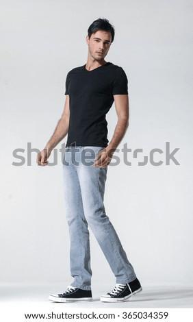 Full length mature casual man walking in studio - stock photo