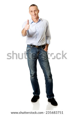 Full length mature man gesturing ok sign.