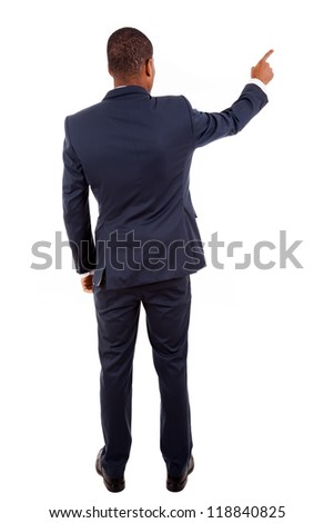 Full length of a African American business man pointing at something on white - stock photo