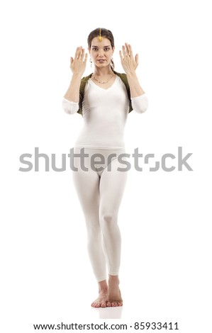 Full length of a beautiful brunette dancer princess Bollywood style isolated over white background - stock photo