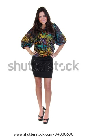 Full length of a beautiful girl in black skirt and colorful blouse - stock photo