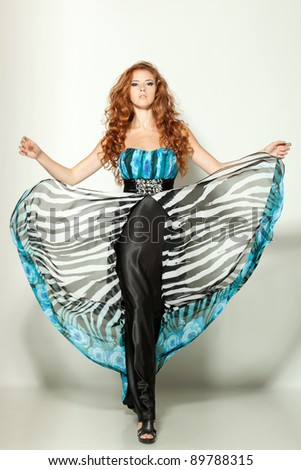Full length of a beautiful red-haired fashion model posing - stock photo