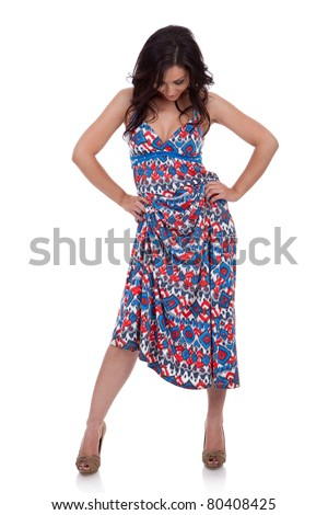 Full length of a beautiful woman looking down - stock photo