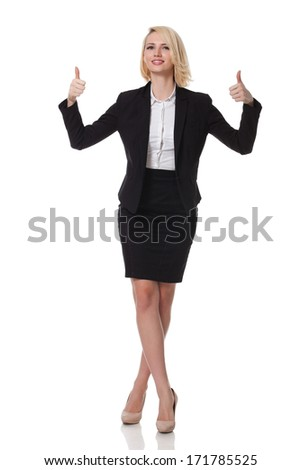 full length of a beautiful young blonde woman standing and smiling showing victory signs with both her hands - stock photo