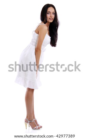 Full length of a beautiful young lady in  dress standing against isolated white background