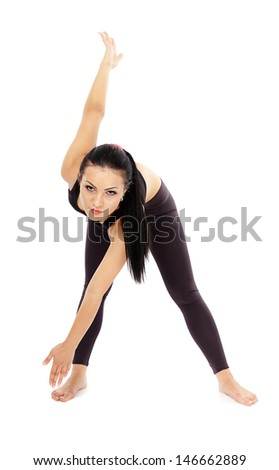 Full length of a brunette caucasian woman doing fitness, stretching