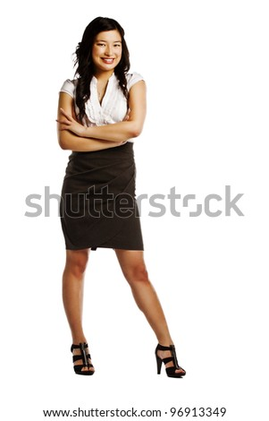 Full length of a confident young business woman with crossed arms on white background - stock photo