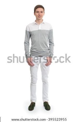 Full length of a cute young man looking at the camera, against white background - stock photo