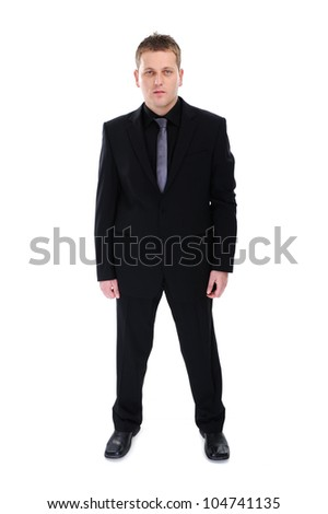 Full length of a handsome business man standing against white background