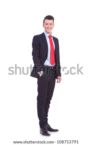 Full length of a handsome business man standing with hand in pocket against white background - stock photo