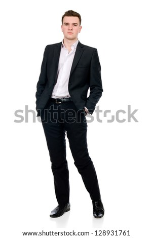 Full length of a handsome business man standing with hands in pocket against white - stock photo