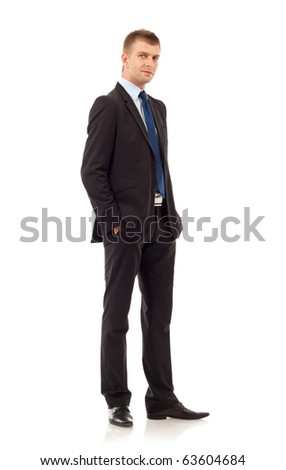 Full length of a handsome business man standing with hands in pocket against white