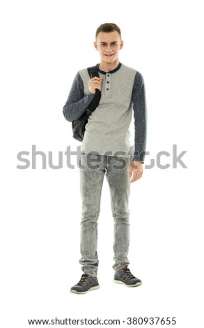 Full length of a handsome teenage boy with backpack on white background - stock photo