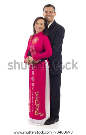 Full length of a happy Asian couple standing together isolated over white background - stock photo