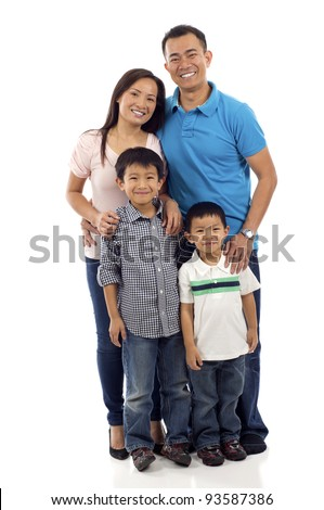 Full length of a happy Asian family of four standing isolated over white background