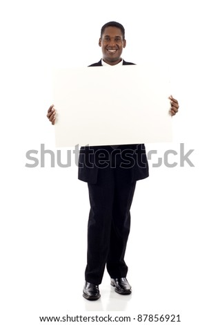 full length of a happy black businessman holding a blank sign isolated white background - stock photo