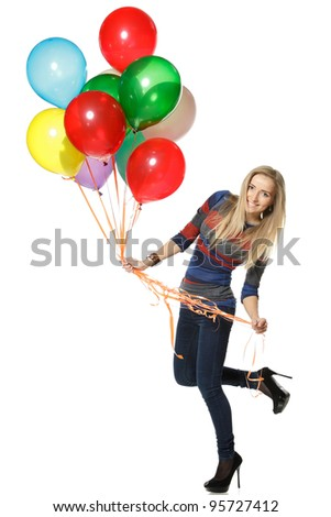 Full length of a happy woman holding balloons against white background - stock photo