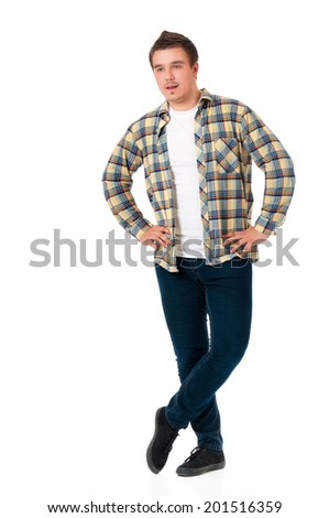 Full length of a happy young man with hands on hips, isolated on white background - stock photo