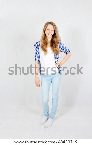 Full length of a happy young teenage girl - stock photo