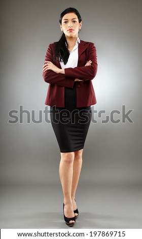 Full length of a hispanic business woman in suit - stock photo