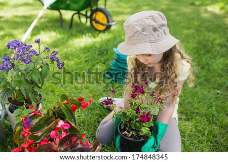 Full length of a little young girl engaged in gardening - stock photo