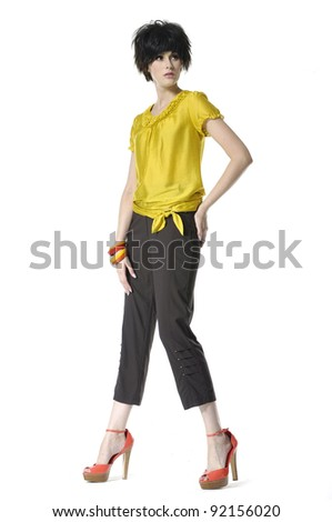 Full length of a model practicing catwalk ,isolated - stock photo