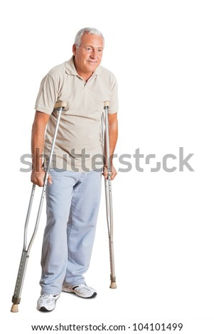 Full length of a senior man on crutches looking away over white background.
